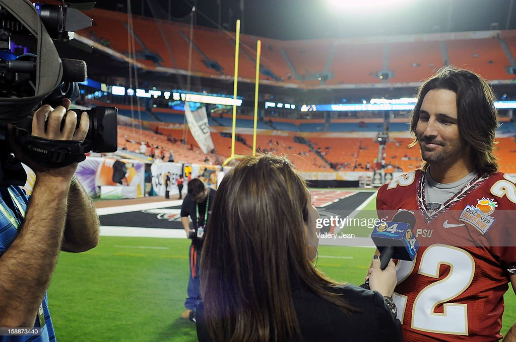 Country Singer <a gi-track='captionPersonalityLinkClicked' href=/galleries/search?phrase=Jake+Owen&family=editorial&specificpeople=619166 ng-click='$event.stopPropagation()'>Jake Owen</a> is interviewed at the 2013 halftime show during the 2013 Discover Orange Bowl at Sunlife Stadium on January 1, 2013 in Miami, Florida.