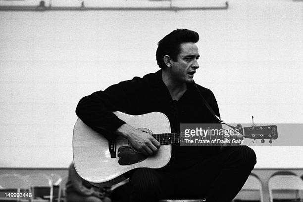 Country singer Johnny Cash backstage on the set of 'The Jimmy Dean Show' on November 20 1964 in New York City New York