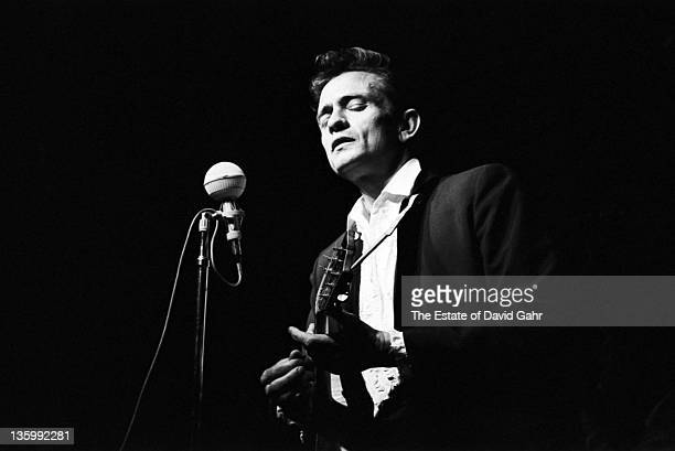 Country singer Johnny Cash performs at the Newport Folk Festival in July 1964 in Newport Rhode Island