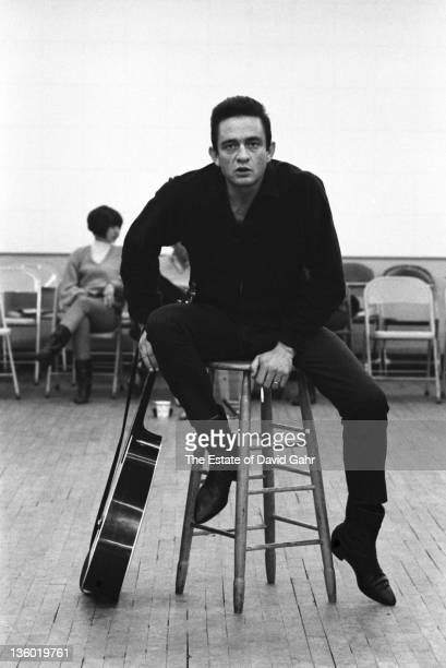 Country singer Johnny Cash poses for a portrait on the set of 'The Jimmy Dean Show' on November 20 1964 in New York City New York