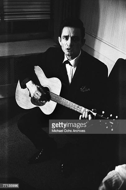 Country singer Johnny Cash warms up backstage at the New York Folk Festival in July of 1965 at Carnegie Hall in New York New York