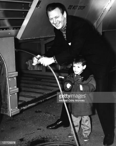 Country singer Johnny Wright poses with his grandson John Sturdivant Jr circa 1965 in Nashville Tennessee