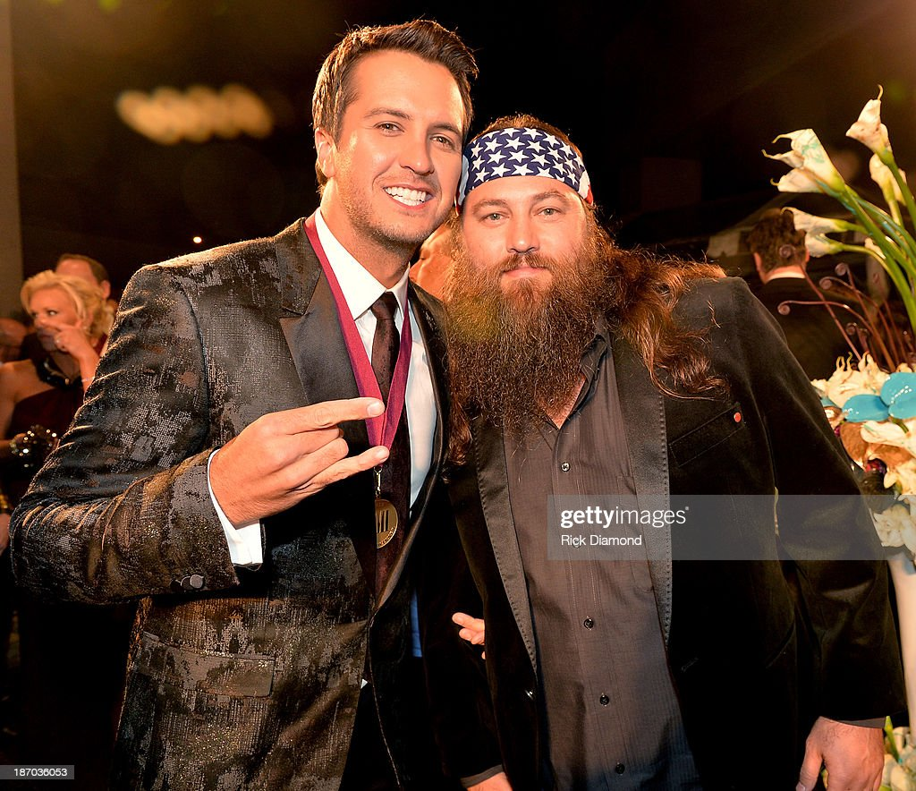 Country singer Luke Bryan and Willie Robertson of Duck Dynasty attend the 61st annual BMI Country awards on November 5, 2013 in Nashville, Tennessee.