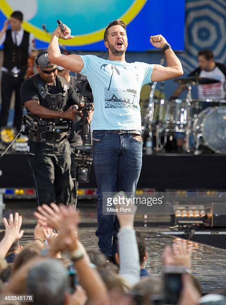 Country Singer Luke Bryan performs on ABC's 'Good Morning America' at Rumsey Playfield Central Park on August 8 2014 in New York City