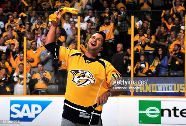 Country singer Luke Bryan waves a rally towel prior to Game Four of the Western Conference First Round between the Nashville Predators and the...