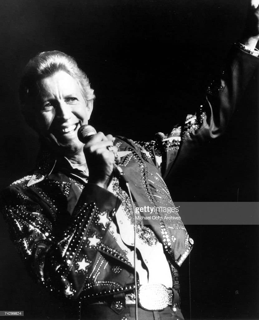 Country singer Porter Wagoner performs onstage in 1969. Mr. Wagoner is wearing a Nudie Suit designed by Nudie Cohn of Nudie's Rodeo Tailors.