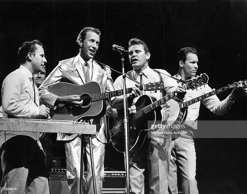 Country singer Porter Wagoner plays a Martin acoustic guitar as he performs onstage with his band in circa 1965.
