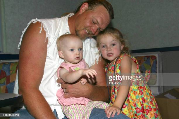 Country singer Trace Adkins cuddles his two kids Brianna and Makenzie before the movie premiere of Veggie Tales