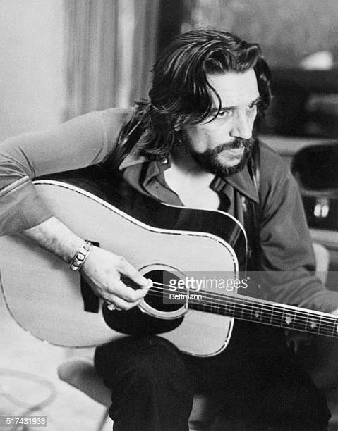 Country Singer Waylon Jennings Playing Acoustic Guitar