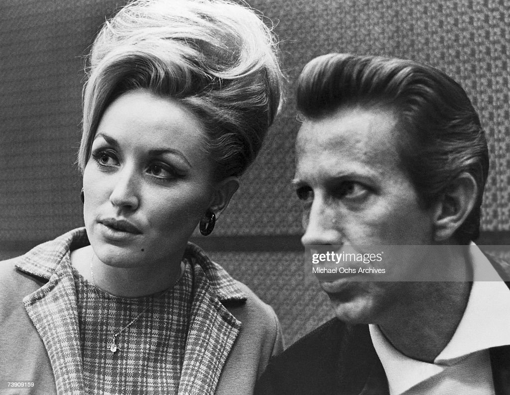 Country singers Dolly Parton and Porter Wagoner in a candid portrait in circa 1968 in Nashville, Tennessee.