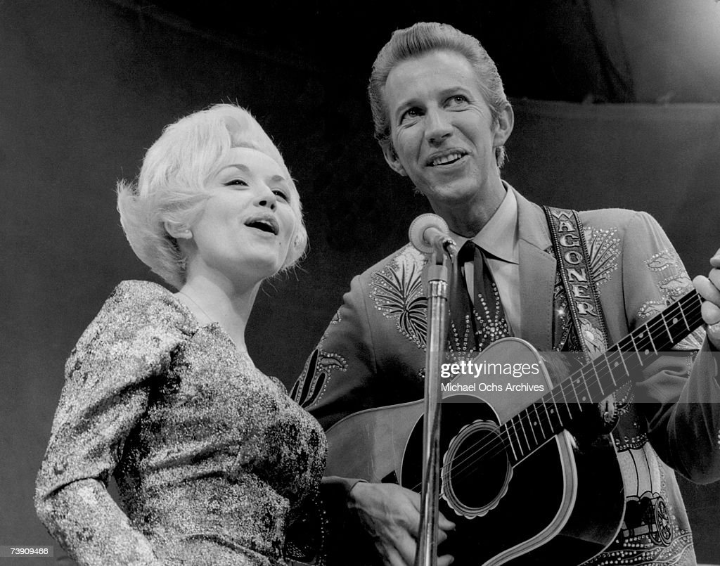 Country singers Dolly Parton and Porter Wagoner perform onstage in circa 1967 in Nashville, TN. Mr. Wagoner is wearing a Nudie suit desgned by Nudie Cohn of Nudie's Rodeo Tailors.