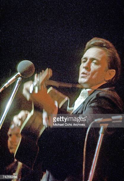 Country singer/songwriter Johnny Cash performs onstage at the New Folk Festival on July 27 1968 in Newport Rhode Island
