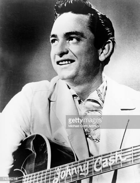 Country singer/songwriter Johnny Cash poses for a Sun Records portrait holding an acoustic guitar in 1957 in Memphis Tennessee
