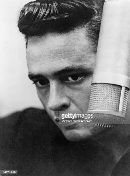 Country singer/songwriter Johnny Cash records in the studio in 1960