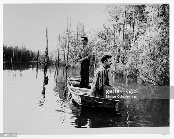 Country singer/songwriters Johnny Horton and Johnny Cash go fishing in May 1959 in Kingsland Arkansas