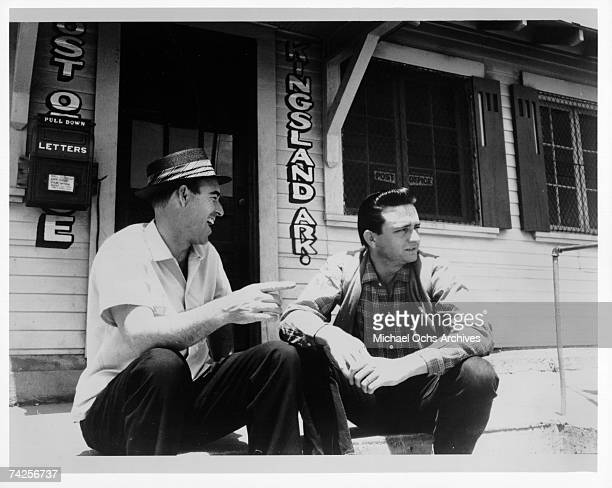 Country singer/songwriters Johnny Horton and Johnny Cash pose for a portrait on the steps of the Kingsland post office in May 1959 in Kingsland...