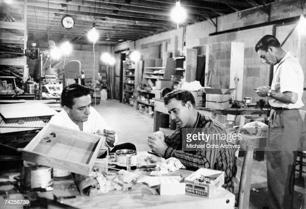 Country singer/songwriters Johnny Horton and Johnny Cash prepare fishing lures in a workshop in May 1959 in Kingsland Arkansas