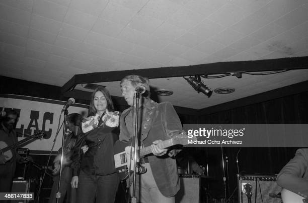 Country star Buck Owens is joined onstage by Emmylou Harris at the Palonino club on March 31 1979 in Los Angeles California