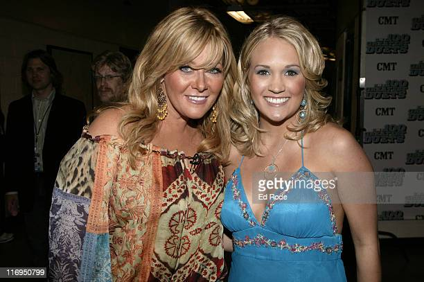 Country star Jamie O'Neal and 'American Idol' winner Carrie Underwood backstage at the CMT's 100 GREATEST DUETS concert A celebration of the the Top...