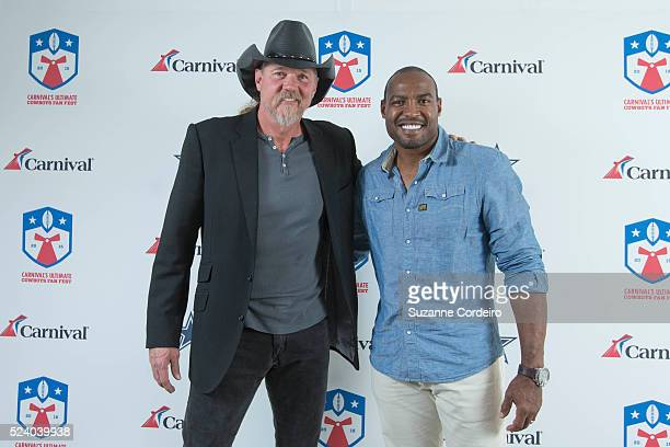 Country star Trace Adkins and Cowboys legend Darren Woodson pose on the red carpet at Carnival's Ultimate Cowboys Fan Fest on October 18 2015 at...