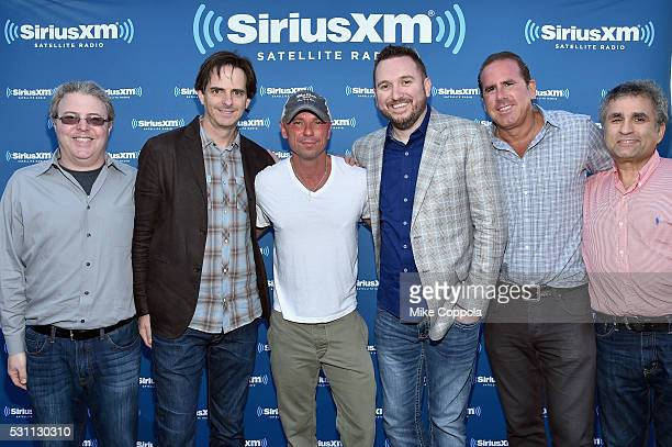 Country Superstar Kenny Chesney poses with SiriusXM Vice President of Marketing Randy Dry SiriusXM Senior Vice President and General Manager of Music...