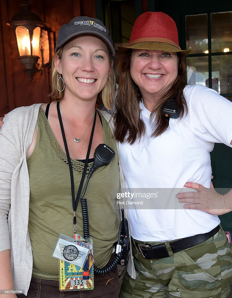 Country Thunder Festival manager April Harbour, modeling an official green Country Thunder USA cap and Country Thunder Artist production manager wearing The DAY 2 Red Fedora with a touch of Green to complement her Camouflage, Laurie Serie backstage at Country Thunder USA - Day 2 on July 25, 2014 in Twin Lakes, Wisconsin.