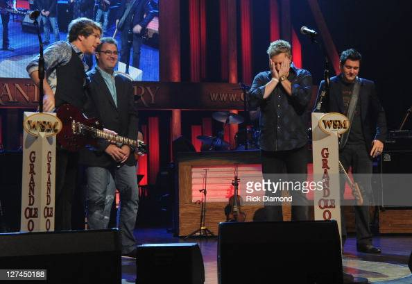 Country Trio Rascal Flatts Joe Don Rooney Gary LeVox and Jay DeMarcus surprised invite by Opry Member Vince Gill to join the Grand Ole Opry Formal...