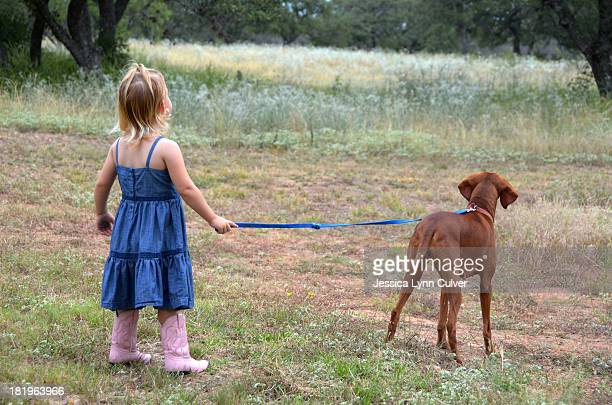 A Country Walk with Girl and Dog
