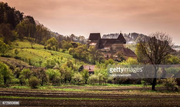 Countryside and church in rural Copsa Mare, Transylvania, Romania