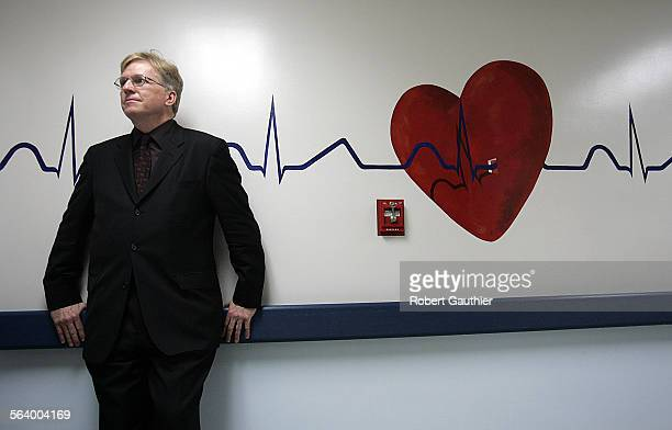 LA County Department of Health Services chief Dr Thomas Garthwaite stands at the entrance to the fouth floor telemetry unit as he talks with a doctor...