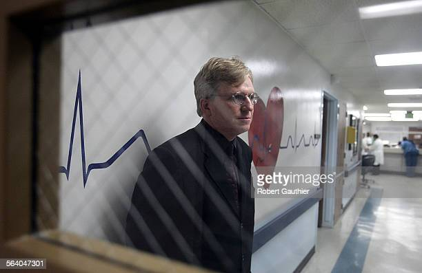 LA County Department of Health Services chief Dr Thomas Garthwaite talks with doctors and nurses at the fourth floor Telemetry Unit while touring...