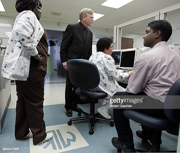 LA County Department of Health Services chief Dr Thomas Garthwaite talks with staffers in the Telemetry unit while touring King Drew Medical Center...