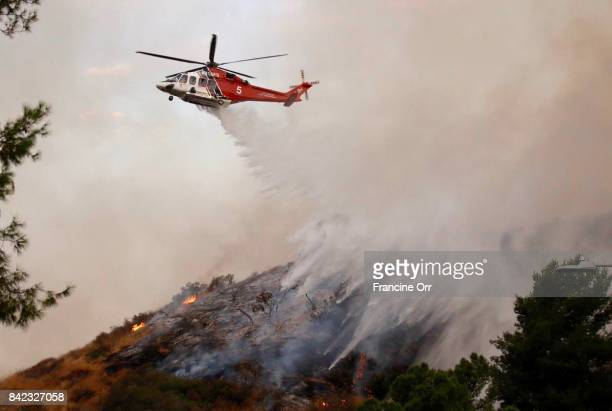 A County Fire helicopter does a water drop above Villa Cabrini Park in Burbank on September 3 2017