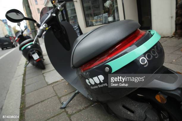 Coup electric scooters stand parked in the city center on November 14 2017 in Berlin Germany A number of companies have plunged into the market for...