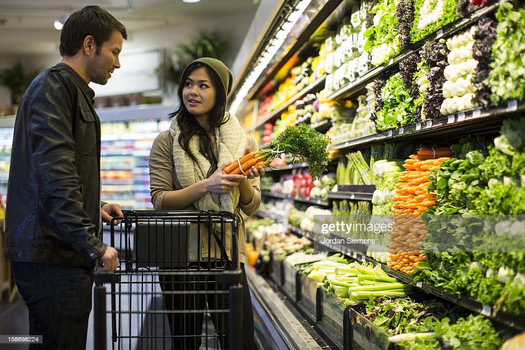 Coupe shopping for groceries. : Stock Photo