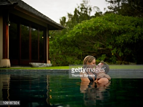 Couple About To Kiss In Pool At Tropical Resort Stock Photo Getty Images