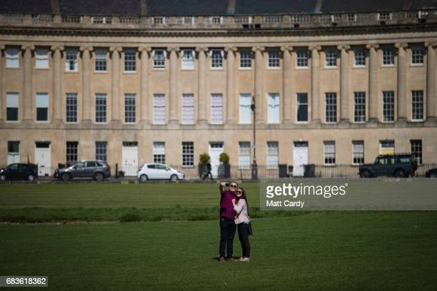 A couple admire the view in front of the Royal Crescent on April 19 2017 in Bath England Designed by the architect John Wood the Younger and built...