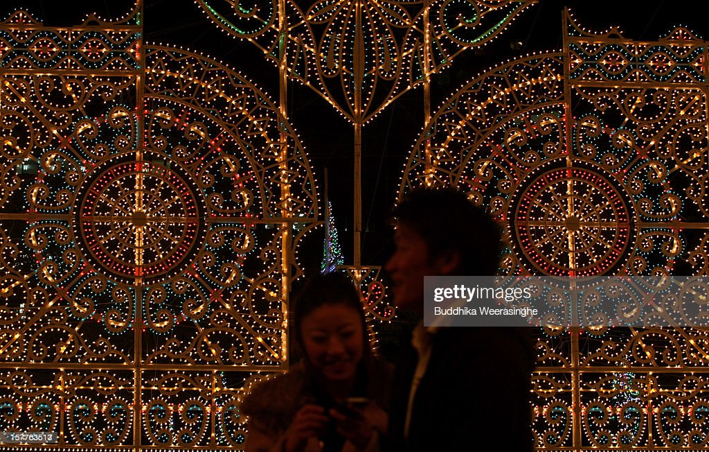 A couple admires the Kobe Luminarie illuminations on December 6, 2012 in Kobe, Japan. Some 200,000 electric bulbs are lit up for the annual Japanese illumination event which begun in 1995 to commemorate the victims of the Hanshin Awaji Great Earthquake and this year will take place from December 6 - 17.