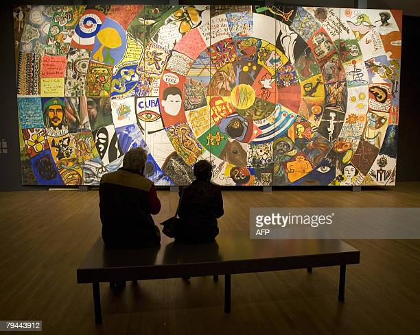 A couple admires the oil on canvas mural 'Cuba colectiva' during 'The Cuba Art and History from 1868 to Today' exhibition 31 January 2008 at the...