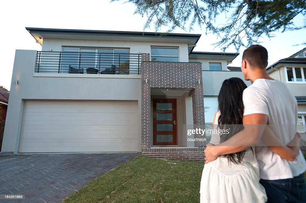 Couple admiring a new house.