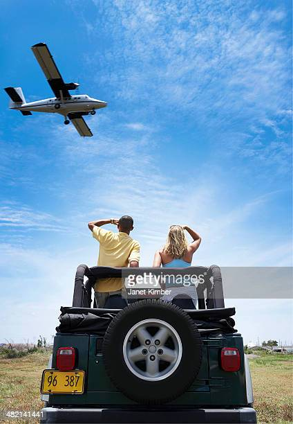 Couple admiring plane from 4x4
