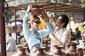 Couple admiring pottery at outdoor market