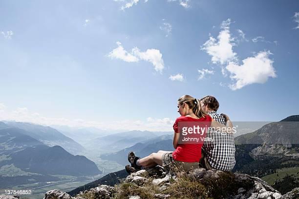 Couple admiring rural landscape