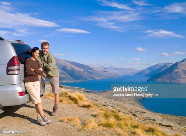 Couple admiring scenic view of lake, Queenstown, South Island, New Zealand
