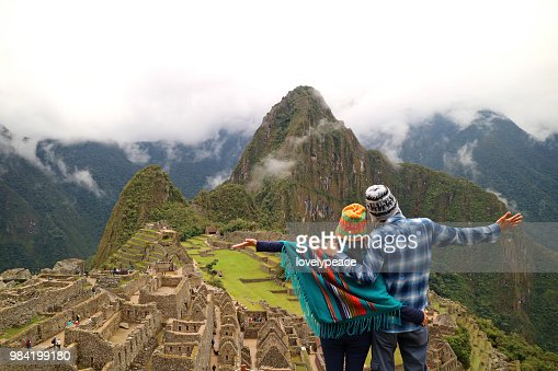 Couple admiring the spectacular view of Machu Picchu, Cusco Region, Urubamba Province, Peru, Archaeological site, UNESCO World Heritage : Stock Photo