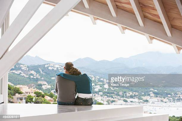 Couple admiring view from balcony