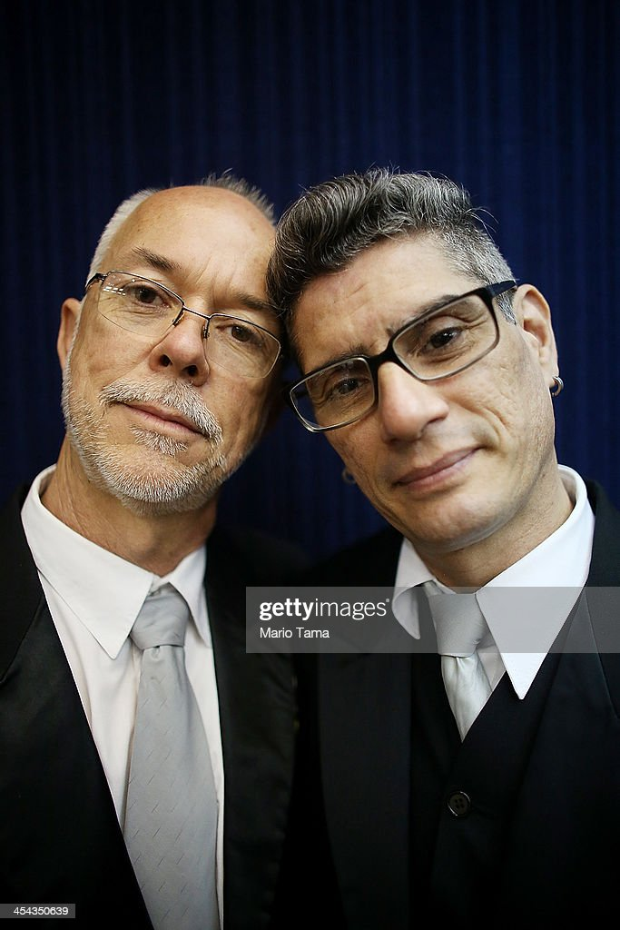 Couple Alex (L) and Jorge pose before marrying at what was billed as the world's largest communal gay wedding on December 8, 2013 in Rio de Janeiro, Brazil. 130 couples were married at the event which was held at the Court of Justice in downtown Rio. In May, Brazil became the third country in Latin America to effectively approve same-sex marriage via a court ruling, but a final law has yet to be passed.