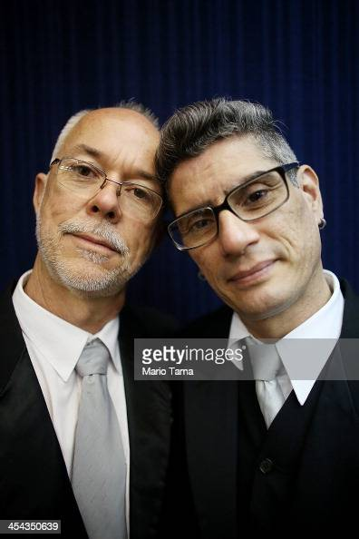 Couple Alex and Jorge pose before marrying at what was billed as the world's largest communal gay wedding on December 8 2013 in Rio de Janeiro Brazil...