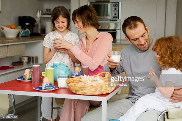 Couple and 2 little girls at breakfast table