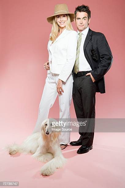 Couple and an afghan hound